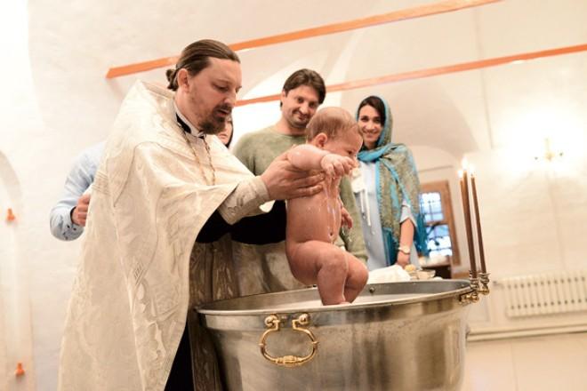 Эдгард Запашный и Ярославна Демешко на крещении сына